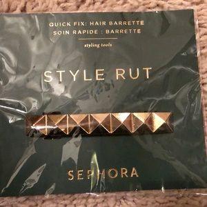 A gold hair barrette